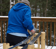 Man waxing skis for easy gliding