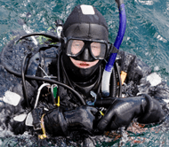 Scuba diver looking at camera in the water