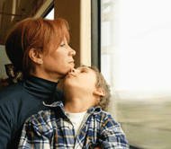 Mother and son on train looking out window